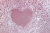 Heart Shaped Bubbles.Abstract, Foam bubbles white background. Detergent