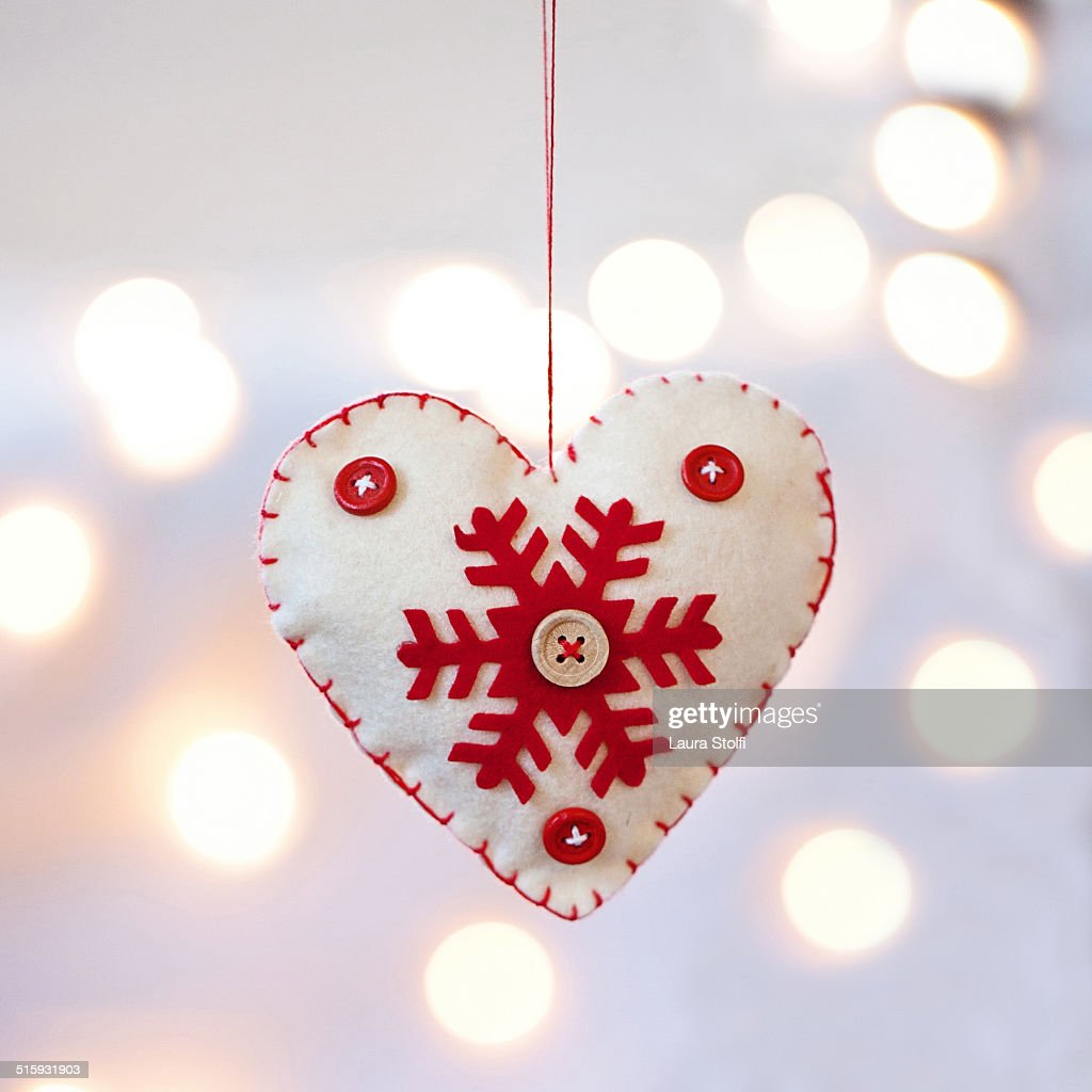 Heart shaped Christmas felt ornament & light bokeh
