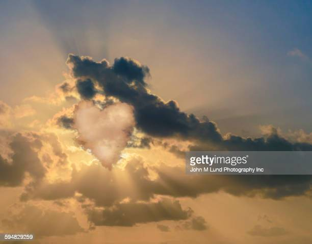 Heart shaped cloud in dramatic sky