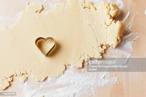 Heart shaped cookie cutter on dough