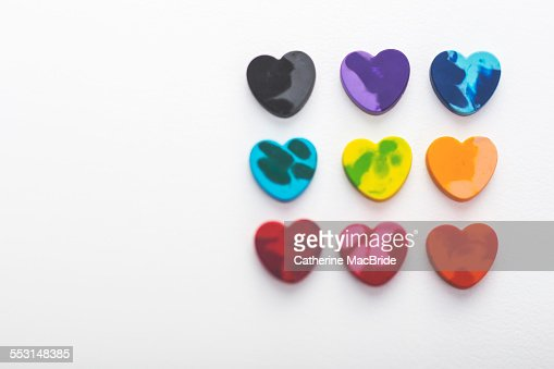 Heart shaped crayons in rows : Stock Photo