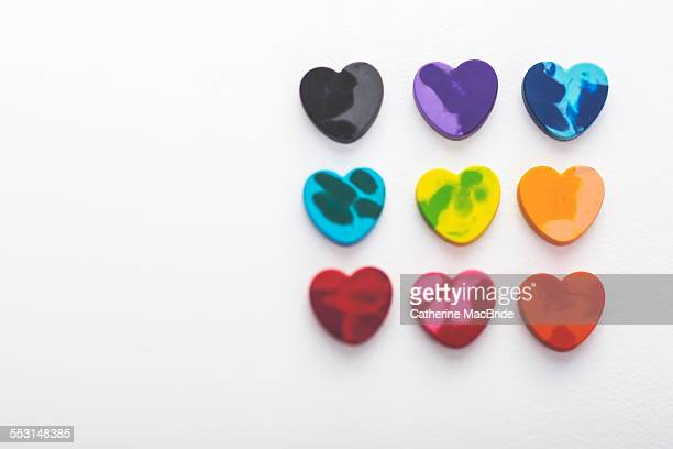 Heart shaped crayons in rows