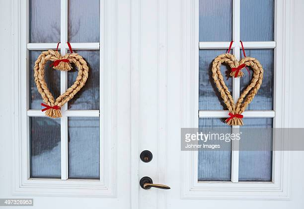 Heart shaped decorations hanging on door, Vastergotland, Sweden