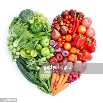 Heart shaped display of green, red healthy foods : Stock Photo