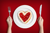 Heart shaped donut on white plate for valentine's day with clipping path