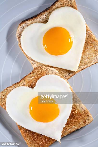 Heart shaped eggs on toast, overhead view, close-up