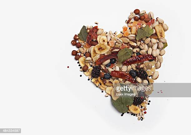 Heart shaped from nuts, dried fruit, and spices