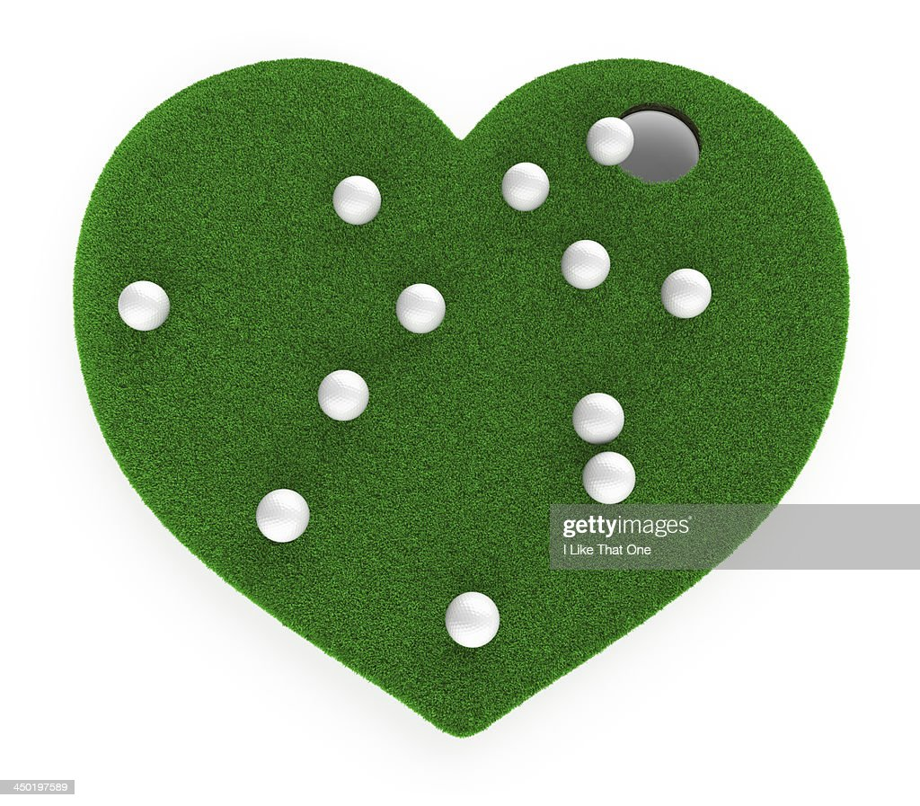 Heart shaped grass with many golfballs near hole : Stock Photo