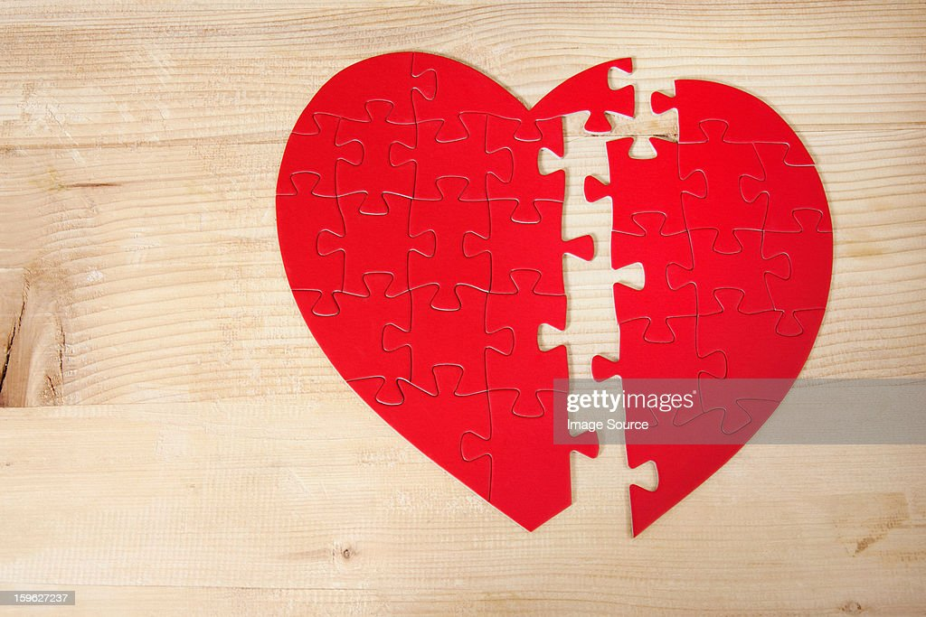 Heart shaped jigsaw puzzle : Stock Photo