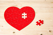 Heart shaped jigsaw puzzle with missing piece