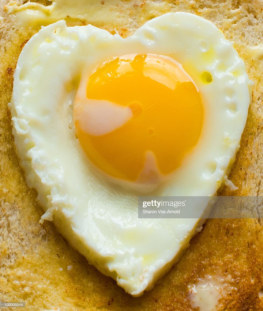 Heart shaped organic egg on wholemeal toast : Stock Photo