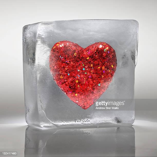 Heart shaped ornament frozen in ice