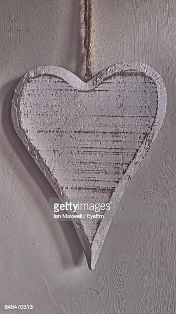 Heart Shaped Pendant Against Wall