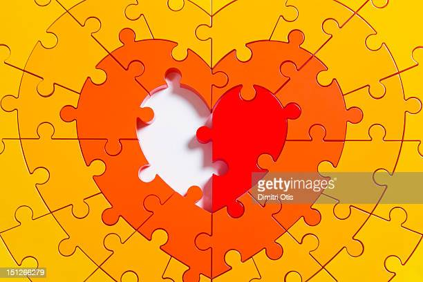 Heart shaped puzzle, missing one centre half