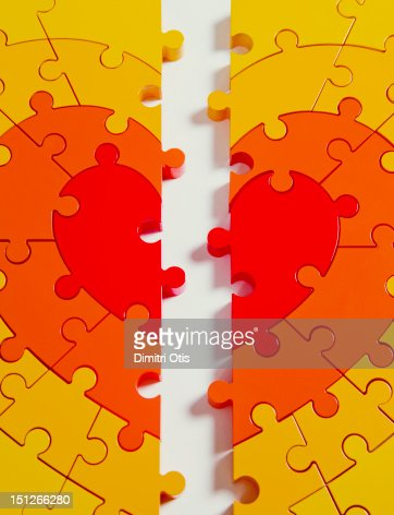 Heart shaped puzzle, split in half, close-up : Stock Photo