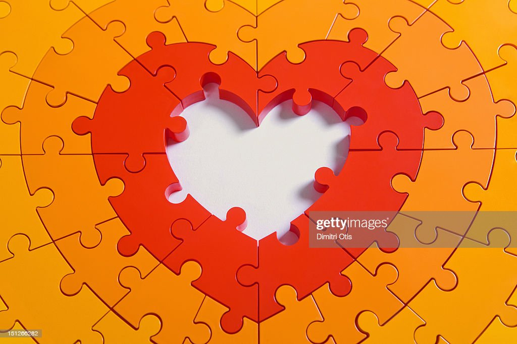 Heart shaped puzzle, with empty centre : Stock Photo
