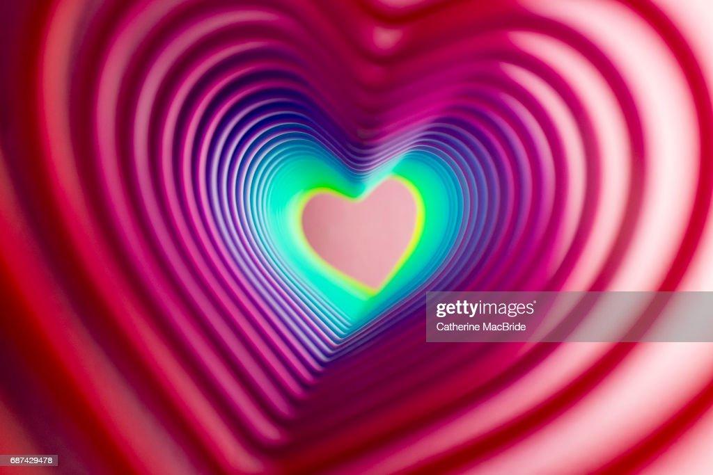 Heart shaped rainbow tunnel : Stock Photo