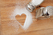 Heart shaped spilt salt on table