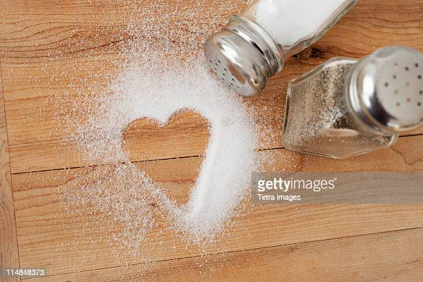 Heart shaped spilt salt on table