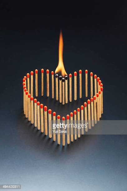 heart shaped stick of the match burning