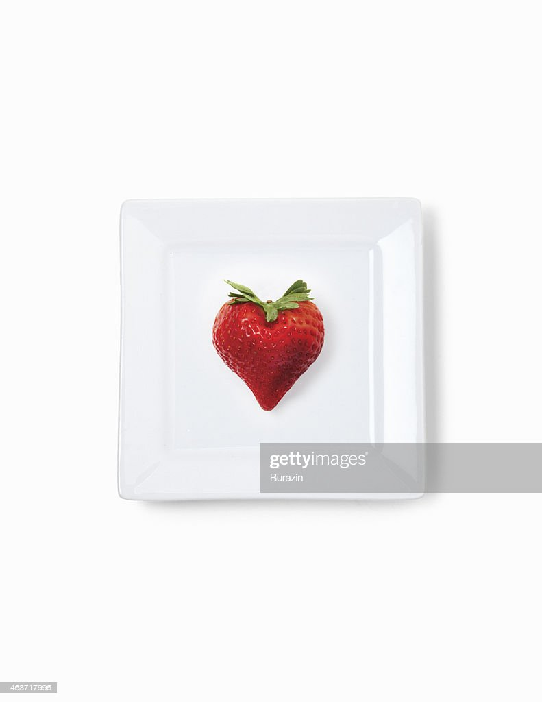 Heart shaped strawberry : Stock Photo