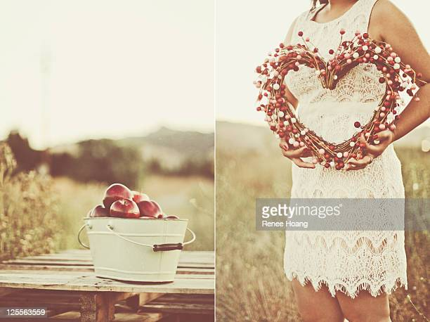 Heart shaped wreath and bucket of apples