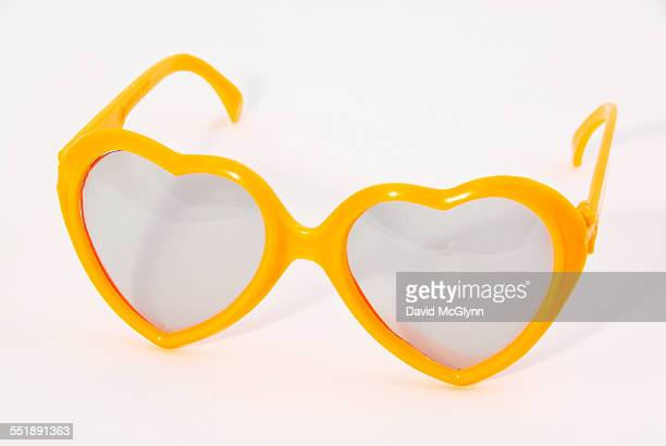 Heart shaped yellow plastic toy glasses
