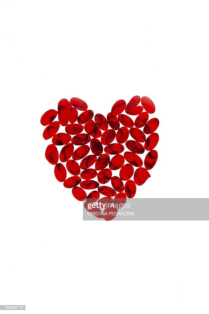 Heart supplements, conceptual image : Stock Photo