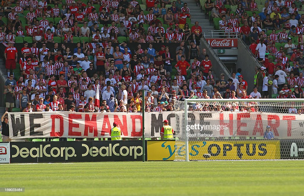 Heart supporters hold a sign aloft during the round 15 A-League match between the Melbourne Heart and the Brisbane Roar at AAMI Park on January 6, 2013 in Melbourne, Australia.