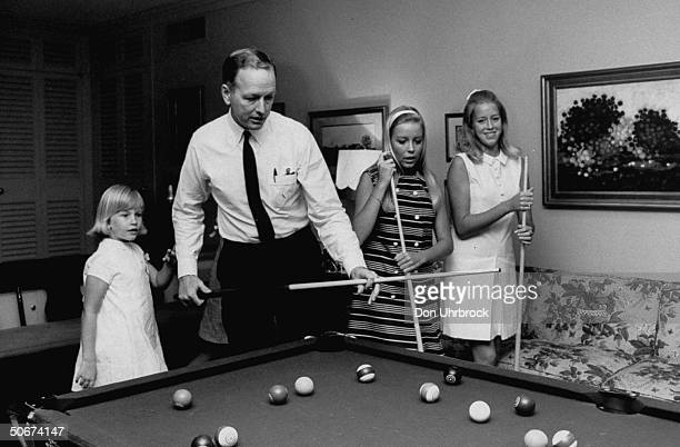 Heart surgeon Dr Denton A Cooley playing billards with his family