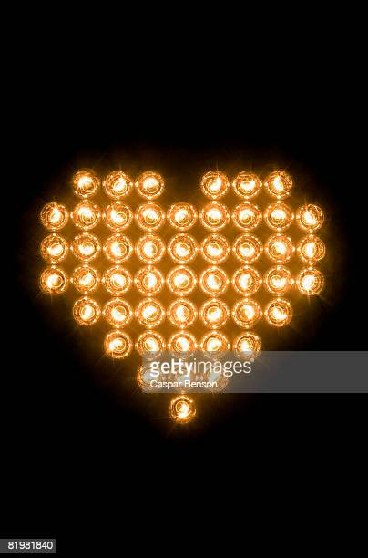 Heart symbol made with illuminated light bulbs