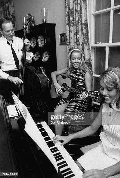 Heart transplant surgeon Dr Denton A Cooley playing music with his daughters