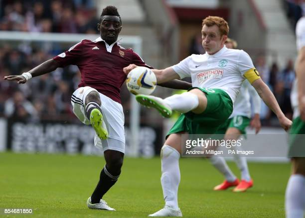 Heart's Buaben Prince challenges Hibernian's Liam Craig during the Scottish Premier League match at Tynecastle Stadium Edinburgh