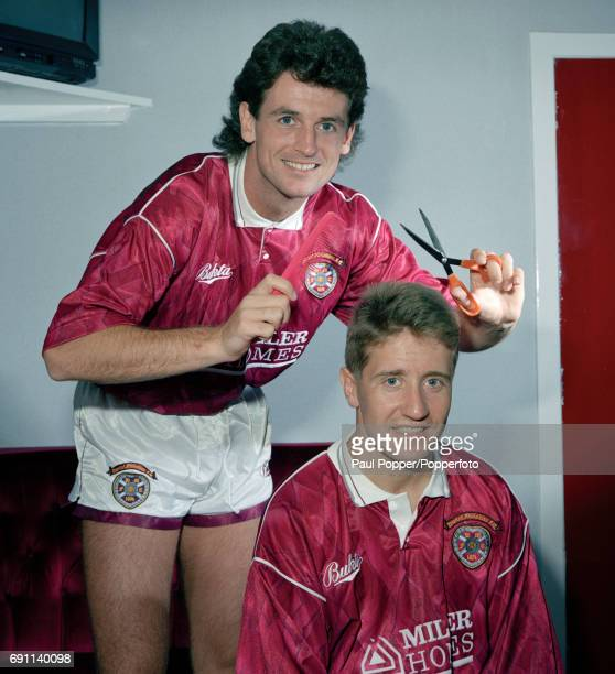 Hearts defender Dave McPherson is poised with the scissors to give teammate John Robertson a trim at Tyncastle in Edinburgh circa 1991