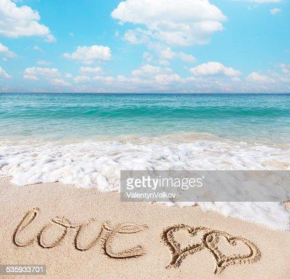 Hearts drawn on the beach. : Stock Photo