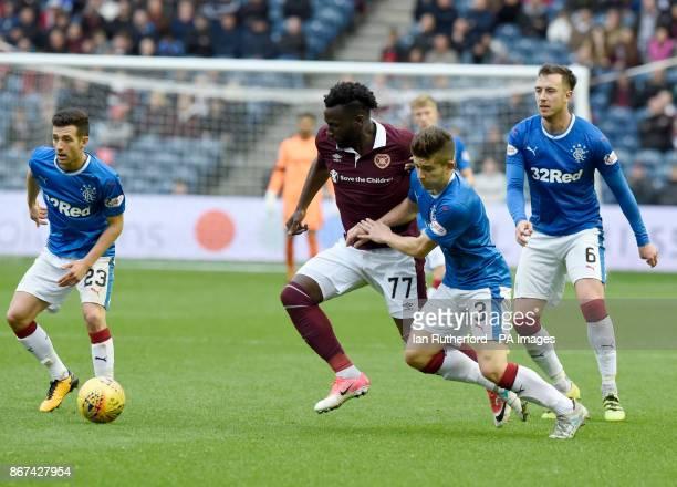 Hearts' Esmael Goncalves in a tussle with Rangers' Declan John during the Ladbrokes Scottish Premiership match at the BT Murrayfield Stadium Edinburgh