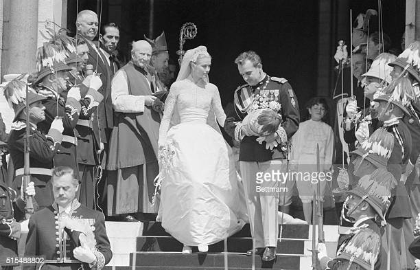 Hearts everywhere were thrilled by the dream like romance of Hollywood actress Grace Kelly and Prince Rainier of Monaco shown here waving to the...
