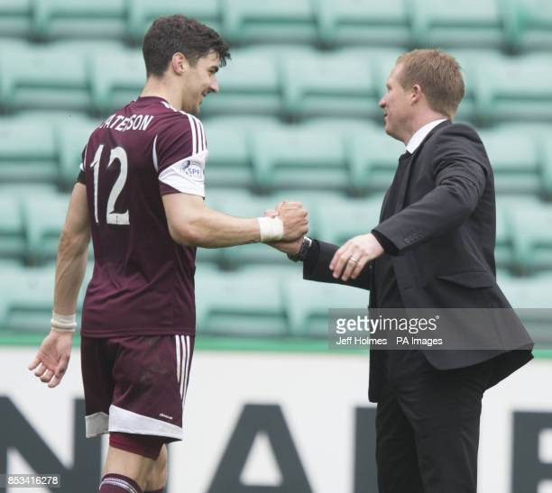 Hearts goal scorer Callum Paterson celebrates at end with mangers Gary Locke after the Scottish Premier League match at Easter Road Edinburgh