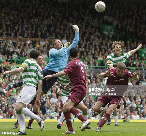 Hearts goalkeeper Marian Kello punches the ball clear of his goal during the Clydesdale Bank Premier League match at Celtic Park Glasgow Scotland