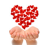 Hearts in heart shape flying over cupped hands of young woman, Valentine's Day, Happy Valentines day, love concept, isolated on white background, birthday card, health insurance concept, hearts are ma