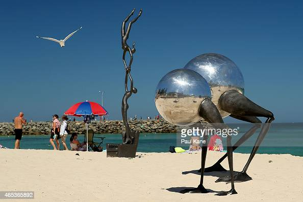 'Hearts in paradise' by artist Ayad Alqaragholli and 'iWanderers Conventus' by artist Brad Jackson are seen at Sculpture By The Sea at Cottesloe...