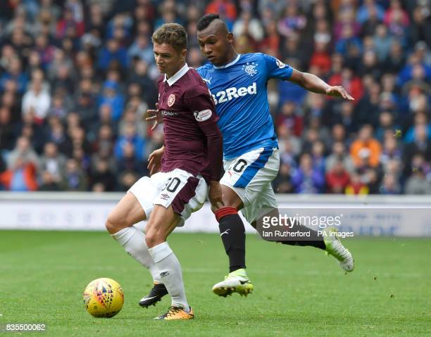 Hearts Jamie Brandon and Rangers Alfredo Morelos battle for the ball during the Scottish Premiership match at Ibrox Glasgow