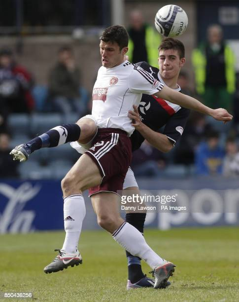 Heart's John Sutton and Dundee's Declan Gallagher battle for the ball during the Clydesdale Bank Scottish Premier League match at Dens Park Dundee