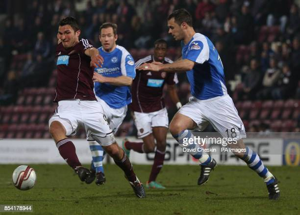 Hearts John Sutton holds off St Johnstone's David McCracken during the Clydesdale Bank Premier League match at the Tynecastle Stadium Edinburgh