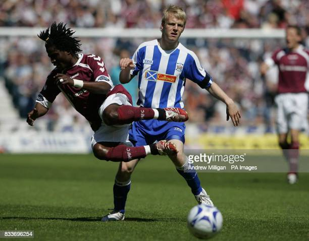 Heart's Laryea Kingston challenges Kilmarnock's Steven Naismith during the Bank of Scotland Premier League match at Rugby Park Kilmarnock