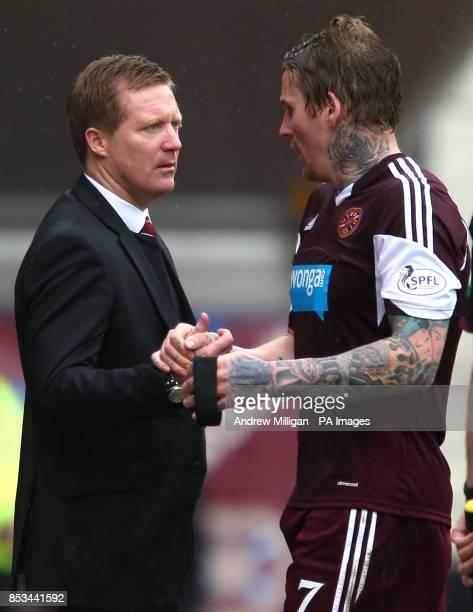 Hearts manager Gary Locke shakes hands with Ryan Stevenson after the Scottish Premiership match at Tynecastle Stadium Edinburgh