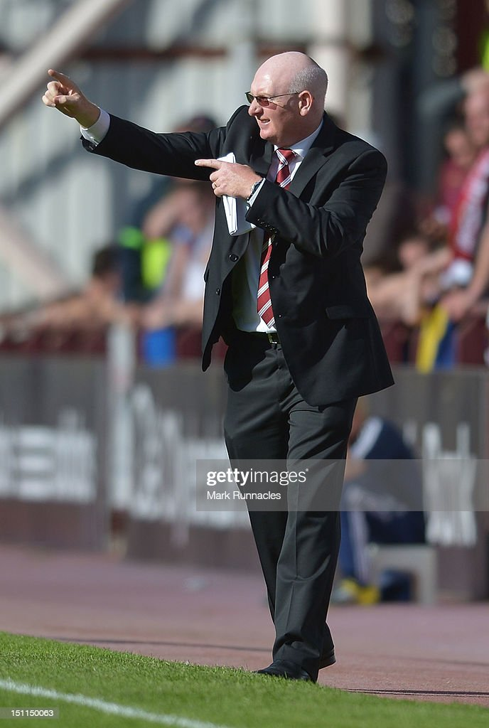Hearts Manager John McGlynn urges his tean forward during the Clydesdale Bank Scottish Premier League match between Hearts and Dundee at Tyncastle Stadium on September 2, 2012 in Edinburgh, Scotland.