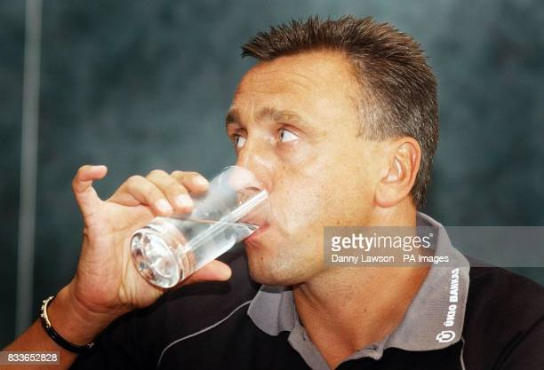 Heart's manager Valdas Ivanauskas takes a drink during a press conference at Murrayfield Stadium Edinburgh