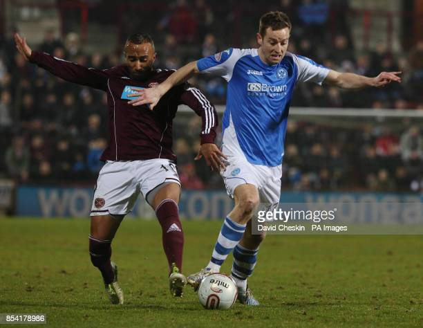 Hearts Mehdi Taouil holds off St Johnstone's Steven Maclean during the Clydesdale Bank Premier League match at the Tynecastle Stadium Edinburgh