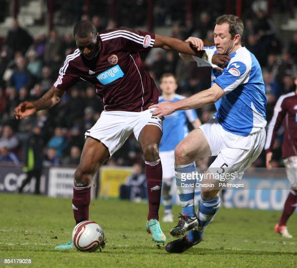 Hearts Michael Ngoo holds off St Johnstone's Frazer Wright during the Clydesdale Bank Premier League match at the Tynecastle Stadium Edinburgh